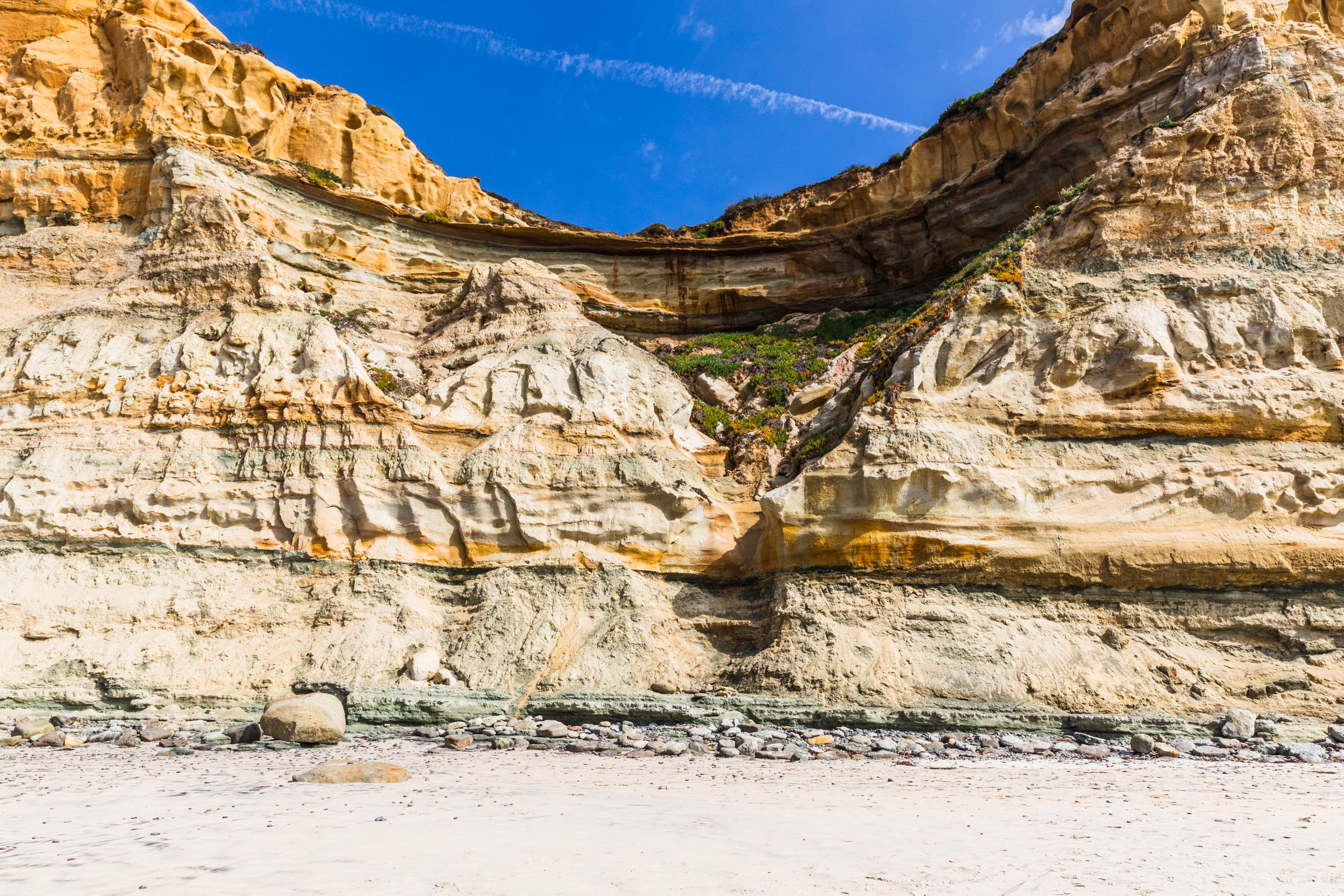 Horizontal landscape shot of a cliff face.